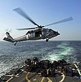 An Sh-60r Sea Hawk Delivers Pallets by Stocktrek Images