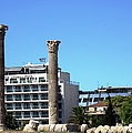 Ancient Greek Columns Or Pillars Standing Tall With One Collapsed In Athens Greece by John Shiron