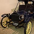 Antique Automobile With Yellow Spoke Wheels by Douglas Barnett