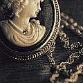Antique Cameo Medallion On Wood by Sandra Cunningham