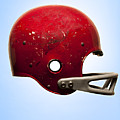 Antique Football Helmet On Blue Background by Chris Parsons