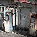Antique Gas Pumps by Mel Hensley