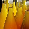 Apple Juice In Bottles by Matthias Hauser