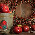 Apples in wood bucket for holiday baking by Sandra Cunningham