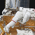 Astronaut Working On The Hubble Space by Stocktrek Images