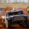 Attard Kicking Up The Dirt by Paul Svensen