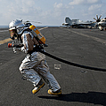 Aviation Boatswain's Mate Carries by Stocktrek Images