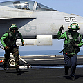Aviation Boatswain Mates Signal A Clear by Stocktrek Images