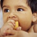 Baby Boy Eating by Ian Boddy