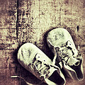 Baby Shoes On Wood by Jill Battaglia