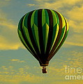 Balloon Ride Through Gold Clouds by Robert Frederick
