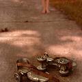 Barefoot Girl On Sidewalk With Roller Skates by Jill Battaglia