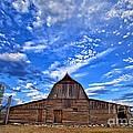 Barn And Clouds by Matt Suess