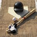 Baseball, Bat, Batting Gloves And Baseball Helmet At Home Plate by Thomas Northcut