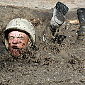 Basic Cadet Trainees Attack The Mud Pit by Stocktrek Images