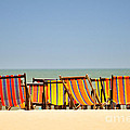 Beach Chairs Colorful  by Panupong Roopyai