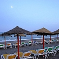 Beach Umbrellas And Chairs Moon Lit Costa Del Sol Spain by John Shiron