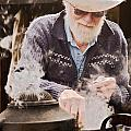 Bearded Miner Making Billy Tea by Sally Weigand
