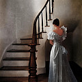 Beautiful Young Woman Standing In Gown By Stairs by Jill Battaglia