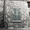 Bicycle Leaning Against A Stone House by Gina Martin