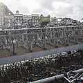 Bicycles Parked On City Sidewalk by jackSTAR
