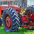 Big Red Rubber Tire Tractor by Randy Harris