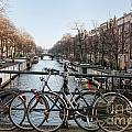 Bikes On The Canal In Amsterdam by Carol Ailles