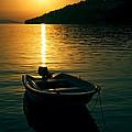 Boat And Sunset by Gennadiy Golovskoy