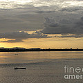 Boat On River At Sunset by Nawarat Namphon