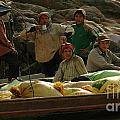 Boatmen In Laos by Bob Christopher