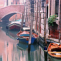Boats Bridge and Reflections in a Venice Canal