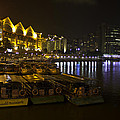Boats Moored To The Side At Clarke Quay In Singapore by Ashish Agarwal