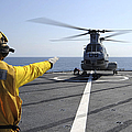 Boatswain's Mate Directs A Ch-46 Sea by Stocktrek Images