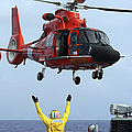 Boatswain Mate Directs A Hh-65a Dolphin by Stocktrek Images