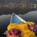 Bouquet Of Flowers In Bow Of Boat Dal by David DuChemin