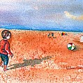 Boy At Beach Playing And Chasing Ball by Sharon Mick