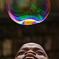 Boy Blowing Bubble by Colin Radford