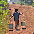 Boy Carrying Drinking Water by Bjorn Svensson