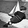 Boy Playing With Toy Sailboat by George Marks