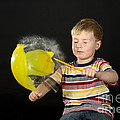 Boy Popping A Balloon by Ted Kinsman