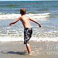 Boy Running Into Surf by Susan Stevenson