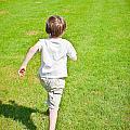 Boy Running by Tom Gowanlock