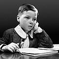 Boy Sitting At Desk W/book by George Marks