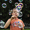 Boy With Colorful Bubbles by Matthias Hauser