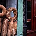 Bread Is Displayed In A Store Window by Raymond Gehman