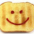Bread With Happy Face by Blink Images