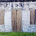 Brick And Wooden Building by Ray Laskowitz