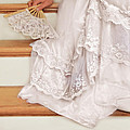 Bride Sitting On Stairs With Lace Fan by Jill Battaglia