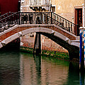 Bridge And Striped Poles Over A Canal In Venice by Greg Matchick