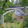 Bridge At Lake Park by Geoff Strehlow